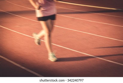 blur young fitness woman running , sunset , vintage