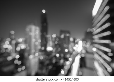 Blure Modern building at night. Traffic in the business district The Skytrain station Chong Nonsi  in black and white, MahaNakhon