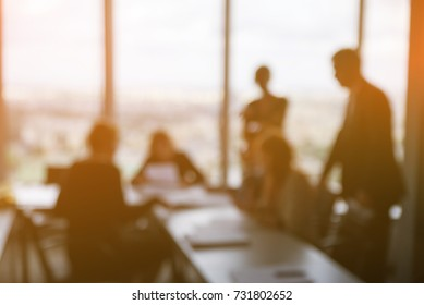 blured business people in office