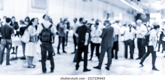 Blured image of businesspeople at coffee break at conference meeting. Business and entrepreneurship. Blue toned grayscale image.