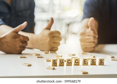 Blured image of bussines group with SUCCESS word on wood blocks concept