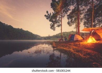 Blured image of camping and tent with high iso grained picture under the pine forest in sunset at Pang-ung, pine forest park , Mae Hong Son, North of Thailand.
