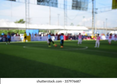 Blured of young kids playing a youth soccer match outdoors