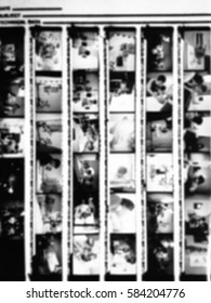 Blurred of 35mm film contact print with film grain on black and white