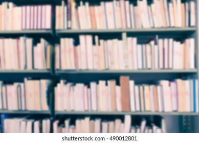 Blurred abstract background of book shelves row and interior of college library with textbooks, literature, menuscript, thesis and magazines. - Vintage Tone.