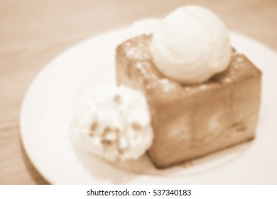 Blurred abstract background and can be illustration to article of honey toast on white dish