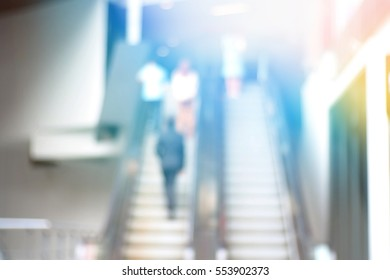 Blurred abstract background and can be illustration to article of business man on escalator