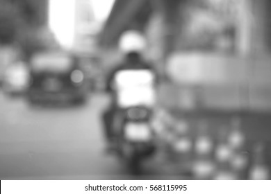 Blurred abstract background and can be illustration to article of Delivery man riding motorcycle