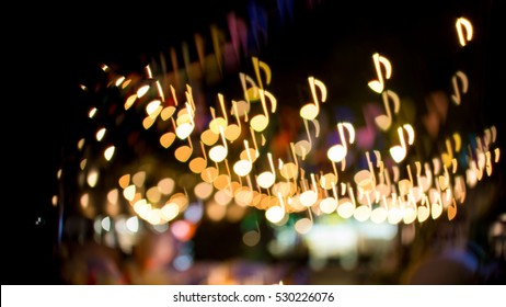 blurred abstract background christmas light with music note bokeh