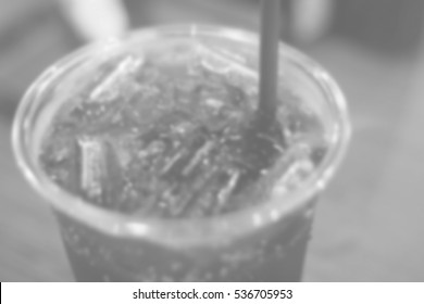 Blurred abstract background of cola glass