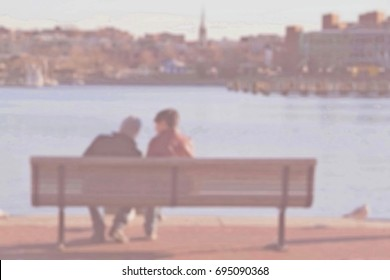 Blurred abstract background of couple sitting on bench at the port. Vintage style.