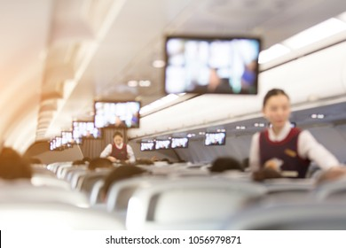 Blurred abstract background of Flight attendant serving passengers on the plane.