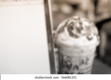 Blurred abstract background of ice cocoa with monitor laptop
