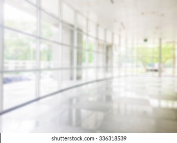 Blurred abstract background interior view looking out toward to empty office lobby and entrance doors