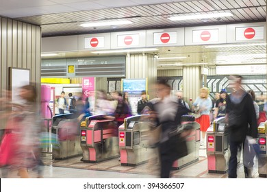 Blurred abstract background of many people at subway station in Tokyo, Japan