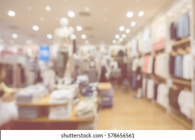 blurred abstract background of multicolored cotton clothing on the shelves of fashion and city shopping people crowd at marketplace shoe shop .vintage color