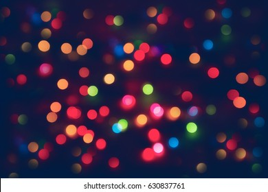 Blurred abstract background nightlife colorful bokeh in red ligth with blue color - Blurry dreamy rooftop view night lights -manual lens