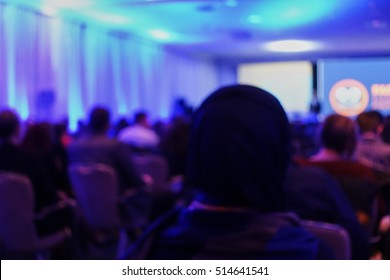 Blurred abstract background of people at conference