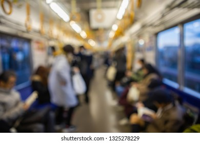 Blurred abstract background of people on subway train, japan