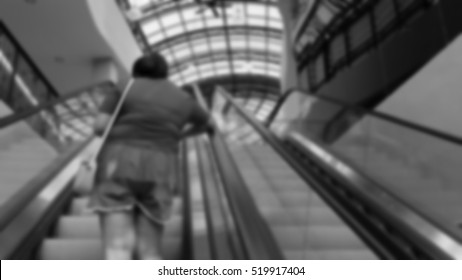Blurred abstract background of people on escalator