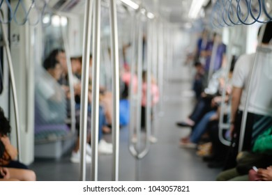 Blurred abstract background of People were traveling by electric train. The business man and woman travel by subway train in the morning time. Many people in city used skytrain to save time.