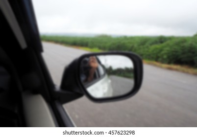 Blurred abstract background of side view mirror