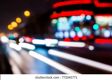 Blurred abstract background. The street lights in a blur. Evening or night city. Light of shop Windows and cars.