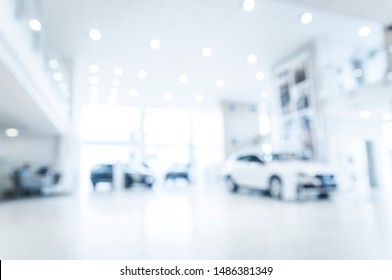 Blurred abstract dealership store, with defocused cars, clients and staff with  soft lightning