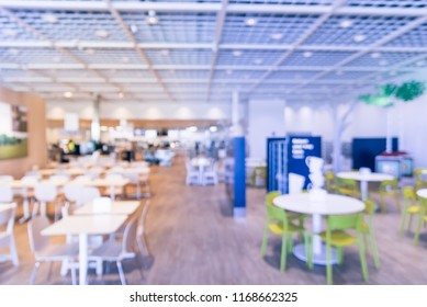 Blurred abstract huge cafeteria, restaurant, canteen, food court at shopping mall or corporate in Texas, America. Defocused modern public dining area for background use