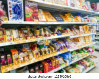 Blurred abstract image. Goods on the shelf of a grocery store. Chocolate and chocolates in boxes.
