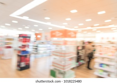 Blurred abstract inside a beauty store in America. Customer shopping for cosmetics, fragrance, skin, hair care products and salon services.