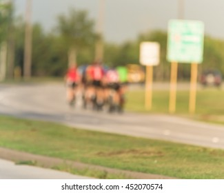 Blurred abstract motion background group of people riding bicycle near city park in Houston, Texas, US. Blurred cycling and outdoor exercise in park. Healthy lifestyle in summer concept.