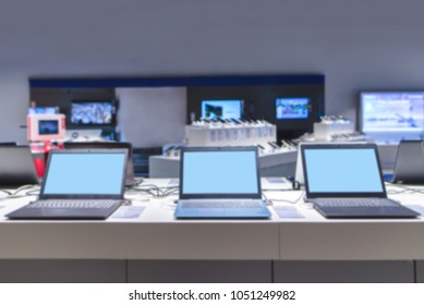 Blurred abstract photo of laptops and electronics store.