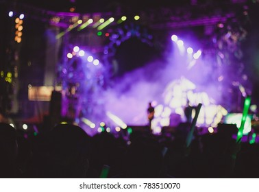 blurred abstract Rock concerts and people put hands up in the light