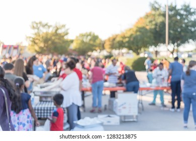 Blurred abstract serving line at church festival near Dallas, Texas, USA. Defocused long queue of diverse and multicultural people attending community event and soup kitchen