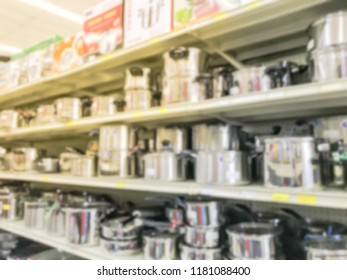 Blurred abstract stainless steel pots on display. Wide selection of houseware and kitchenware on shelves at Asian supermarket in America. Kitchen hand-held tools, gadget necessities