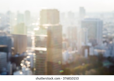 Blurred aerial view of Bangkok skyline on amazing beauty golden warm light sunrise. Beautiful hotel, resident of Bangkok city, Thailand, Asia. Insurance, Investment, industry concept.