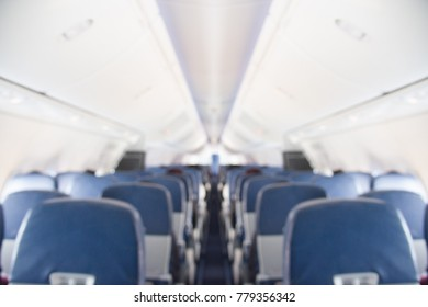 Blurred airplane interior for background.Interior of airplane with passengers on seats waiting to taik off