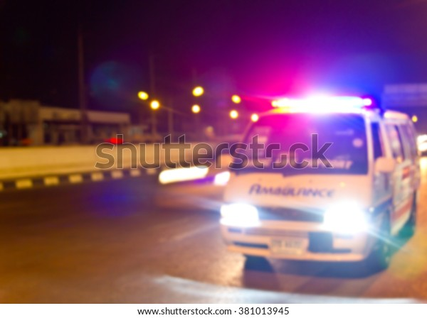 Blurred of Ambulance car on road : Vintage Light