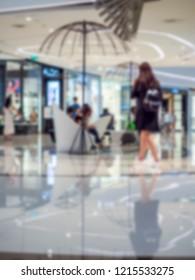 Blurred , Asia women walkin hallway at the shopping mall