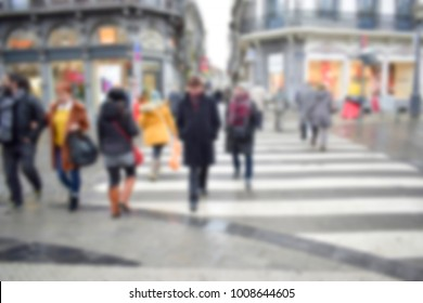 Blurred of asian and european people crossing on street from the pedestrian crossing in the city shopping center, Belgium. Safety travel and holiday concept.