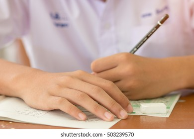 Blurred of asian student testing in exercise, exams answer sheets or test paper with pen, : education concept