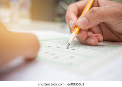 blurred of Asian, Thai student testing in exercise, or taking exams answer sheets in school class room