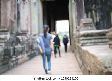 blurred asian woman traveling at angkor wat, siem reap combodia.