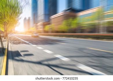 blurred asphalt road through modern city in China