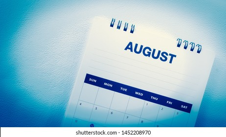 Blurred August calendar on blue tone.