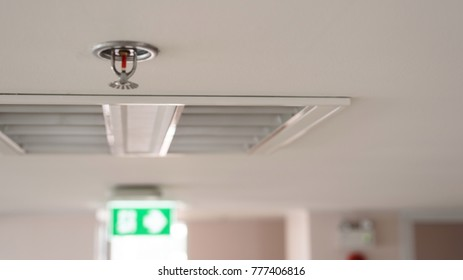 Blurred of automatic head fire sprinkler extinguisher on the ceiling.Fire fighting concept.