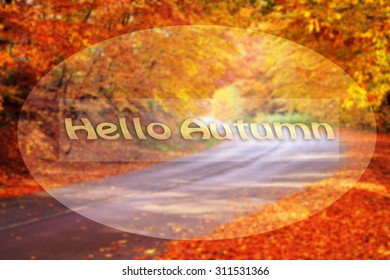 blurred autumn road and text hello autumn added in frame