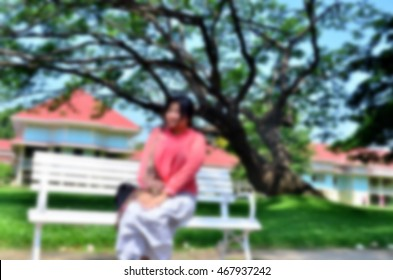 Blurred  background abstract and can be illustration to article of people sitting at park