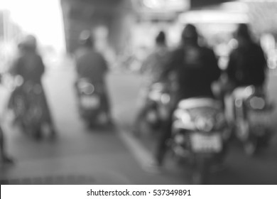 Blurred  background abstract and can be illustration to article of Bikers driving a motorcycle
